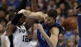 San Antonio Spurs center LaMarcus Aldridge (12) dunks as Dallas Mavericks forward Maximilian Kleber (42) defends during the second half of an NBA basketball game in Dallas, Tuesday, March 12, 2019. (AP Photo/Tony Gutierrez)