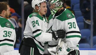 Dallas Stars forward Roope Hintz (24) and goalie Ben Bishop (30) celebrate the team's 2-0 victory over the Buffalo Sabres in an NHL hockey game Tuesday, March 12, 2019, in Buffalo, N.Y. (AP Photo/Jeffrey T. Barnes)