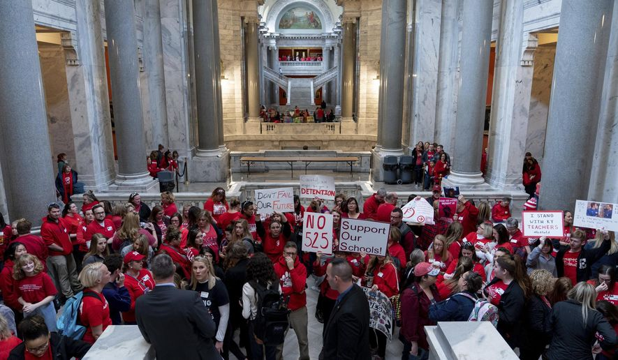 Teachers, and their supporters, gather outside the Senate Chambers in the Capitol to protest perceived attacks on public education, in Frankfort, Ky, Tuesday, March 12, 2019. Kentucky's largest school district is closed again as about one third of its teachers called in sick so they could protest at the state Capitol. (AP Photo/Bryan Woolston)