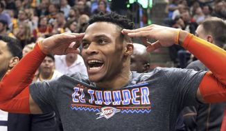 Oklahoma City Thunder guard Russell Westbrook (0) celebrates after a teammate scores against the Utah Jazz in the second half during an NBA basketball game, Monday, March 11, 2019, in Salt Lake City. (AP Photo/Rick Bowmer)