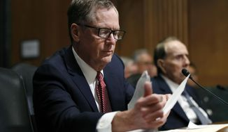 "FILE - In this March 14, 2017, file photo, United States Trade Representative-nominee Robert Lighthizer, foreground, looks at documents during his confirmation hearing on Capitol Hill in Washington.  Lighthizer, the top U.S. trade negotiator, suggests that the U.S. and China are nearing an agreement that would end their trade conflict, but wouldn't commit to a specific time frame. ""Our hope is that we are in the final weeks of having an agreement,"" U.S. Trade Representative Lighthizer told the Senate Finance Committee. (AP Photo/Manuel Balce Ceneta, File)"