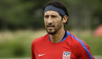 FILE - In this  July 18, 2017, file photo, United States' Omar Gonzalez moves across the field to speak with members of the media at the University of Pennsylvania in Philadelphia. Gonzalez and Tim Ream are back with the U.S. national team for the first time since 2017, and new coach Gregg Berhalter, US Soccer announced Tuesday, March 12, 2019. (AP Photo/Matt Rourke, File)