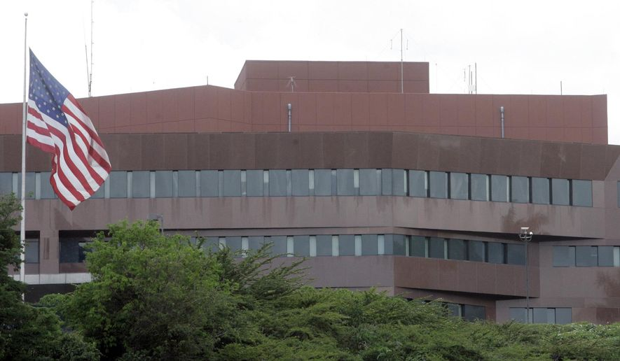 FILE - This Sept. 12, 2008 file photo, shows the U.S. embassy in Caracas, Venezuela. The U.S. Secretary of State Mike Pompeo has announced on Monday, March 11, 2019, that it will withdraw all remaining U.S. personnel from the U.S. Embassy in Caracas, Venezuela this week. (AP Photo/Howard Yanes, File)