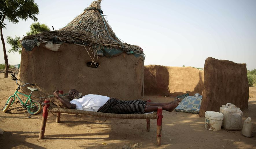 FILE - In this Oct. 7, 2016 file photo, a man rests on a bed in front of his hut at a camp for internally displaced people near the town of Abs, in the Hajjah governorate, of Yemen. The U.N. Office for the Coordination of Humanitarian Affairs, or OCHAU.N. warned in a report Tuesday, March 12, 2019, that thousands of Yemeni civilians caught in fierce clashes between warring factions are trapped in the embattled northern district of Hajjah. The number of displaced in the district has doubled over the past six months, the humanitarian agency said. (AP Photos Hani Mohammed, File)