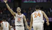Virginia Tech's Ahmed Hill (13) reacts as he congratulates Kerry Blackshear Jr. (24) after a basket against Miami during the first half of an NCAA college basketball game in the Atlantic Coast Conference tournament in Charlotte, N.C., Wednesday, March 13, 2019. (AP Photo/Chuck Burton) ** FILE **