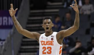 Syracuse's Frank Howard (23) reacts after a basket against Pittsburgh during the first half of an NCAA college basketball game in the Atlantic Coast Conference tournament in Charlotte, N.C., Wednesday, March 13, 2019. (AP Photo/Chuck Burton) **FILE**