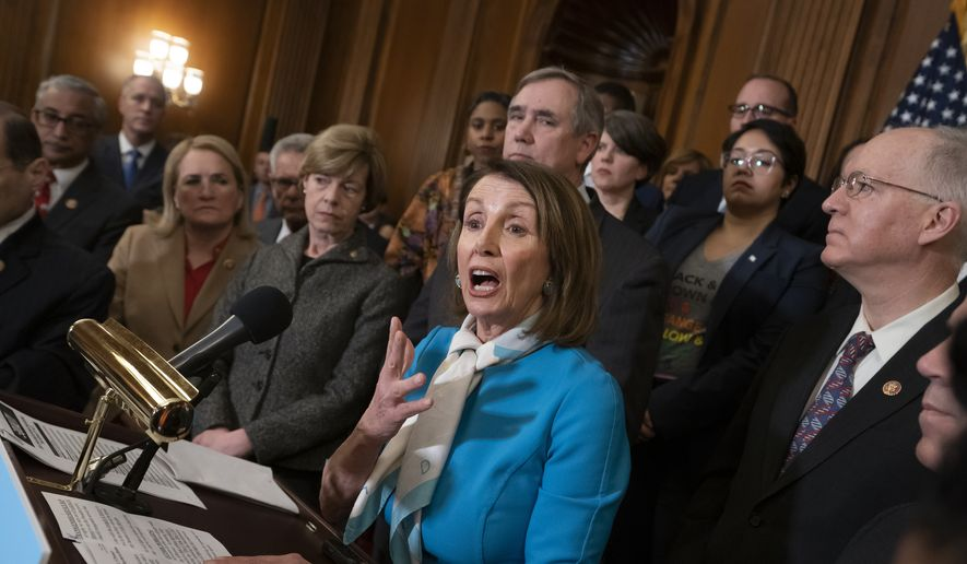 Speaker of the House Nancy Pelosi, D-Calif., and fellow Democrats introduce The Equality Act, a comprehensive nondiscrimination bill for LGBT rights, at the Capitol in Washington, Wednesday, March 13, 2019. (AP Photo/J. Scott Applewhite)