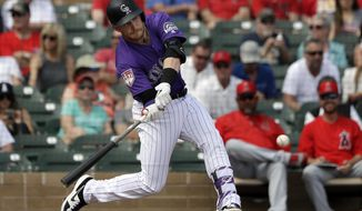 Colorado Rockies' Trevor Story doubles against the Los Angeles Angels in the second inning of a spring training baseball game Wednesday, March 6, 2019, in Scottsdale, Ariz. (AP Photo/Elaine Thompson)