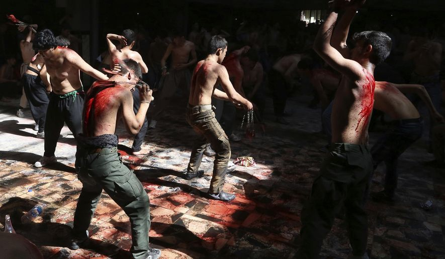 FILE - In this Sunday, Oct. 9, 2016 file photo, Shiite Muslim men beat themselves with knives attached to chains during a procession to mark Ashoura in Kabul, Afghanistan. In a report released on Wednesday, March 13, 2019, researchers say self-flagellation should be added to the list of ways to spread a dangerous viral blood infection. (AP Photo/Rahmat Gul)