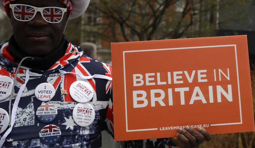 A pro-Brexit leave the European Union supporter takes part in a protest outside the House of Parliament in London, Wednesday, March 13, 2019. European Union officials on Wednesday criticized the U.K. Parliament for rejecting a Brexit deal for a second time as the bloc prepared for a chaotic, cliff-edge departure. (AP Photo/Kirsty Wigglesworth)