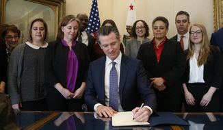 Gov. Gavin Newsom signs the executive order placing a moratorium on the death penalty at his Capitol office Wednesday, March 13, 2019, in Sacramento, Calif. (AP Photo/Rich Pedroncelli) **FILE**