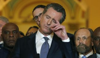 California Gov. Gavin Newsom pauses as he responds to a reporter's question about his decision to place a moratorium on the death penalty during a news conference at the Capitol, Wednesday, March 13, 2019, in Sacramento, Calif. (AP Photo/Rich Pedroncelli)