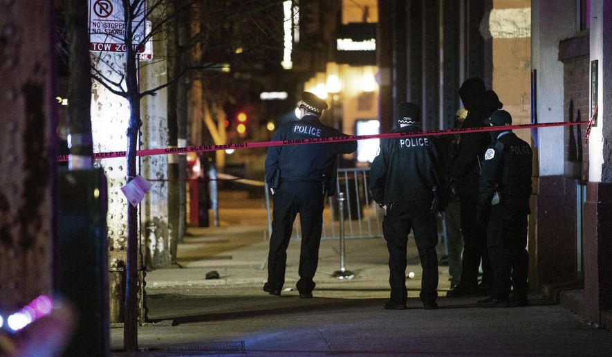 Chicago police investigate the scene of a shooting outside a nightclub in Chicago, early Friday, March 8, 2019. Police say in a statement that there was a fight involving about 15 people early Friday outside Sound-Bar in the city's River North district. Investigators say on person involved pulled a handgun and fired shots. (Tyler LaRiviere/Chicago Sun-Times via AP)