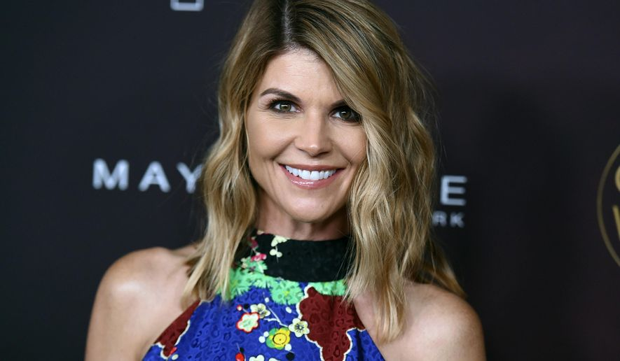"Actress Lori Loughlin arrives at the 5th annual People Magazine ""Ones To Watch"" party in Los Angeles.(Photo by Richard Shotwell/Invision/AP, File)"
