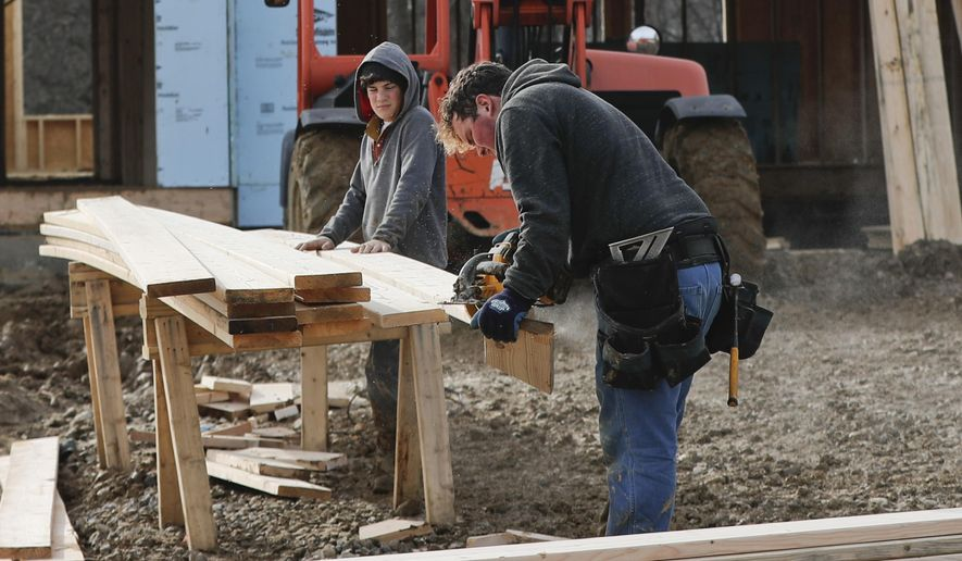 In this Jan. 4, 2019, photo work continues on a plan of new homes in Franklin Park, Pa. On Wednesday, March 13, the Commerce Department reports on U.S. construction spending in January. (AP Photo/Keith Srakocic)