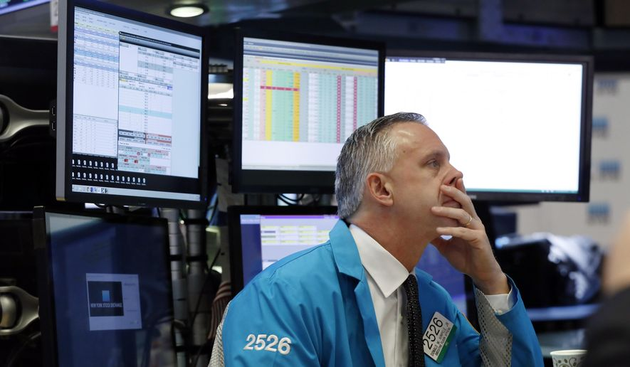 FILE- In this March 11, 2019, file photo specialist Donald Himpele Jr. works at his post on the floor of the New York Stock Exchange. The U.S. stock market opens at 9:30 a.m. EDT on Wednesday, March 13. (AP Photo/Richard Drew, File)