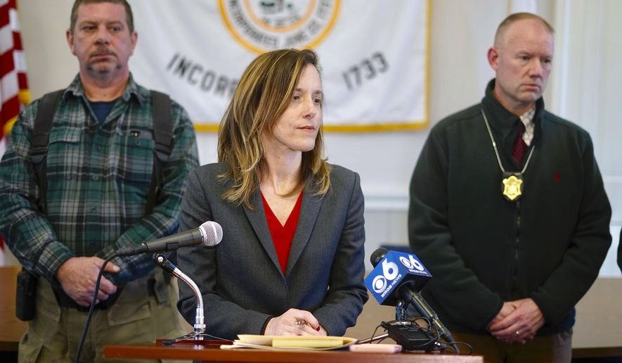District Attorney Andrea Harrington, center, speaks during a news conference Wednesday, March 13, 2019, at Sheffield Town Hall about a house fire on Home Road that took the lives of five people in Sheffield, Mass. Behind Harrington are Sheffield Fire Chief Brent Getchell, left, and Massachusetts State Police Lt. Detective Ed Culver. (Ben Garver/The Berkshire Eagle via AP)