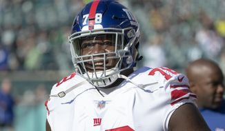 FILE - In this Nov. 25, 2018, file photo, New York Giants offensive guard Jamon Brown looks before an NFL football game against the Philadelphia Eagles in Philadelphia. After Matt Ryan agreed to restructure his contract to clear cap space, the Atlanta Falcons spent that money on two new starting guards, Jamon Brown and James Carpenter, to help protect the quarterback. (AP Photo/Chris Szagola, File)