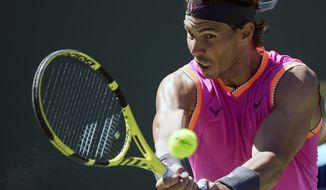 Rafael Nadal, of Spain, returns a shot to Filip Krajinovic, of Serbia, at the BNP Paribas Open tennis tournament Wednesday, March 13, 2019, in Indian Wells, Calif. (AP Photo/Mark J. Terrill)