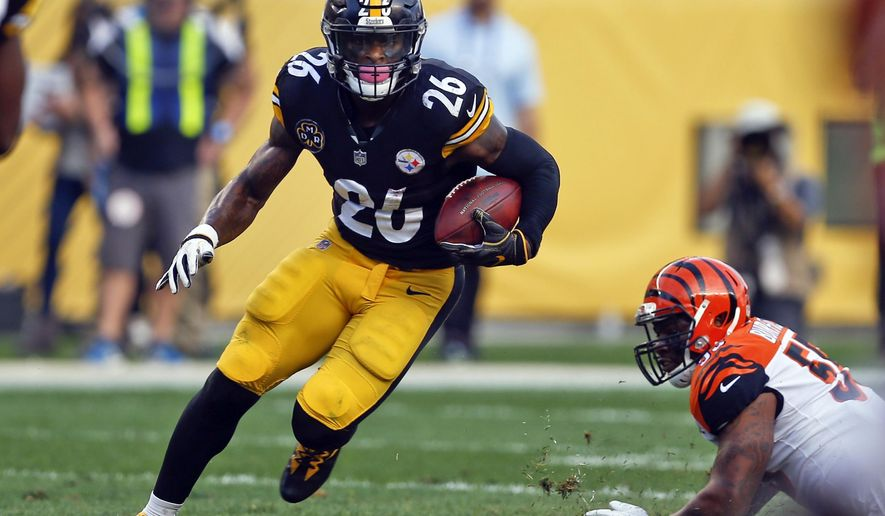 FILE - In this Oct. 22, 2017, file photo, Pittsburgh Steelers running back Le'Veon Bell (26) carries the ball during an NFL football game against the Cincinnati Bengals in Pittsburgh. A person with direct knowledge of the negotiations says the New York Jets and Bell have agreed to a deal early Wednesday morning, Mach 13, 2019, a person with direct knowledge of the negotiations told The Associated Press. The deal gives new coach Adam Gase and second-year quarterback Sam Darnold a big-time playmaker, arguably the best player at his position before Bell opted to sit out all of last season rather than sign a franchise tender with Pittsburgh. (AP Photo/Keith Srakocic, File)