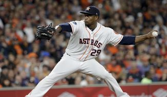 FILE - In this Oct. 16, 2018, file photo, Houston Astros relief pitcher Tony Sipp throws against the Boston Red Sox during the sixth inning in Game 3 of a baseball American League Championship Series, in Houston. A person familiar with the deal tells The Associated Press that left-handed reliever Tony Sipp and the Washington Nationals have agreed in principle on a one-year contract that guarantees $1.25 million and includes a mutual option for 2020.The person spoke on condition of anonymity Wednesday, March 13, 2019, because the deal was pending the successful completion of a physical exam. (AP Photo/David J. Phillip, File) **FILE**