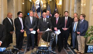 South Carolina Gov. Henry McMaster stands with several legislators to talk about the states efforts to get the Carolina Panthers a new practice facility, Wednesday, March 13, 2019, in Columbia, S.C. Lawmakers will try to pass a bill making football players full-time workers under state law so the Panthers could get t tax credits. (AP Photo/Jeffrey Collins)