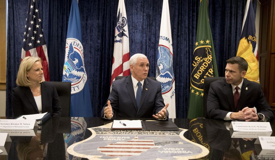 Vice President Mike Pence, center, accompanied by and Homeland Security Secretary Kirstjen Nielsen, left, and U.S. Customs and Border Protection Commissioner Kevin McAleenan, right, speaks during a briefing at the U.S. Customs and Border Protection Advanced Training Facility in Harpers Ferry, W.Va. Wednesday, March 13, 2019. (AP Photo/Andrew Harnik)