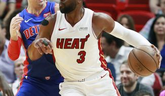 Miami Heat guard Dwyane Wade (3) drives against Detroit Pistons guard Luke Kennard during the first half of an NBA basketball game, Wednesday, March 13, 2019, in Miami. (AP Photo/Wilfredo Lee)