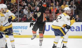 Anaheim Ducks' Daniel Sprong, center, of the Netherlands, celebrates his goal next to Nashville Predators' Matt Irwin, right, during the second period of an NHL hockey game, Tuesday, March 12, 2019, in Anaheim, Calif. (AP Photo/Jae C. Hong)