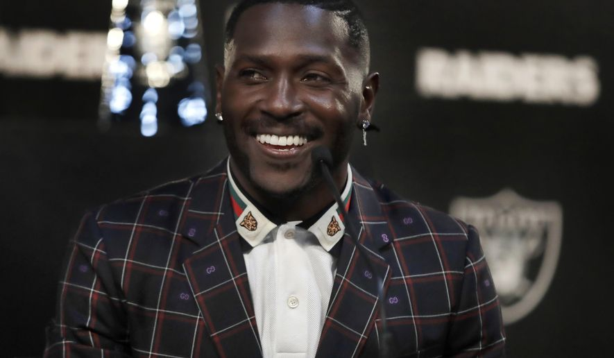 Oakland Raiders wide receiver Antonio Brown smiles during the NFL football team's news conference Wednesday, March 13, 2019, in Alameda, Calif. (AP Photo/Ben Margot)