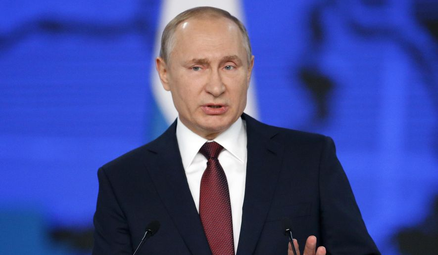 """In this file photo taken on Wednesday, Feb. 20, 2019, Russian President Vladimir Putin delivers a state-of-the-nation address in Moscow, Russia. Asked about the allegations of collusion between Trump's campaign and Russia, Putin has charged that the continuing U.S. political infighting reflects a """"lack of respect for the voters,"""" who elected Trump. (AP Photo/Alexander Zemlianichenko, File)"""