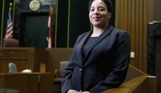 "FILE - In this May 5, 2017, file photo, St. Louis Circuit Attorney Kim Gardner poses for a photo in St. Louis. An attorney for St. Louis Circuit Attorney Kim Gardner is accusing police, a special prosecutor and a judge of trying to ""intimidate and humiliate"" her through a search warrant of electronic records in her office. The search warrant is part of an investigation into whether a man Gardner hired last year to investigate former Gov. Eric Greitens lied under oath during a deposition. (AP Photo/Jeff Roberson, File)"