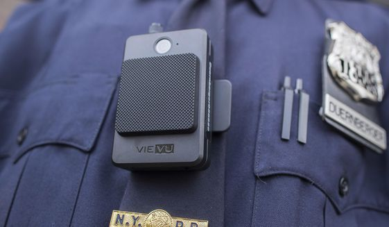 In this April 27, 2017 file photo, a police officer wears a newly-issued body camera outside in New York. The Kansas City, Missouri, police department announced in September 2020 that its officers will all be issued body cameras in early 2021. (AP Photo/Mary Altaffer)  **FILE**