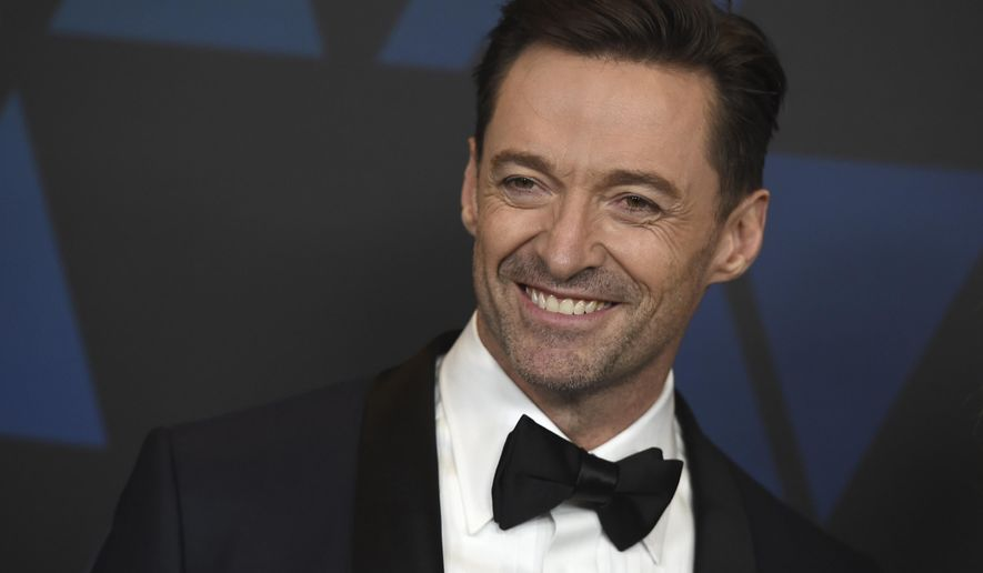 "FILE- In this March 13, 2019, file photo Hugh Jackman arrives at the Governors Awards at the Dolby Theatre in Los Angeles. Jackman is coming back to Broadway as a classic roguish traveling salesman. Producer Scott Rudin said Wednesday, March 13, 2019, that the two-time Tony-winner will star in a revival of ""The Music Man"" starting in September 2020. (Photo by Jordan Strauss/Invision/AP, File)"