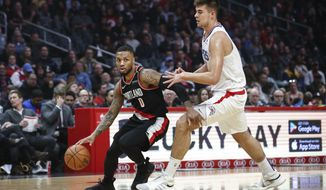 Portland Trail Blazers' Damian Lillard, left, drives against Los Angeles Clippers' Ivica Zubac during the first half of an NBA basketball game Tuesday, March 12, 2019, in Los Angeles. (AP Photo/Ringo H.W. Chiu)