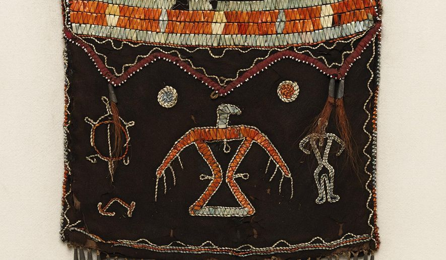 """This photo provided by The Metropolitan Museum of Art shows a shoulder bag that is part of the exhibit """"Art of Native America: The Charles and Valerie Diker Collection,"""" which runs through Oct. 6, 2019 at the museum in New York. (Bruce Schwarz/The Metropolitan Museum of Art via AP)"""