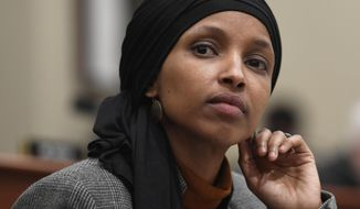 In this March 12, 2019, photo, Rep. Ilhan Omar, D-Minn., listens as Office of Management and Budget Acting Director Russ Vought testifies before the House Budget Committee on Capitol Hill in Washington. Debate in Congress over Israel and anti-Semitism is providing President Donald Trump an opening to appeal to Jewish American voters (AP Photo/Susan Walsh)