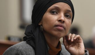 Rep. Ilhan Omar, D-Minn., listens as Office of Management and Budget Acting Director Russ Vought testifies before the House Budget Committee on Capitol Hill in Washington, March 12, 2019. Debate in Congress over Israel and anti-Semitism is providing President Donald Trump an opening to appeal to Jewish American voters (AP Photo/Susan Walsh) ** FILE **