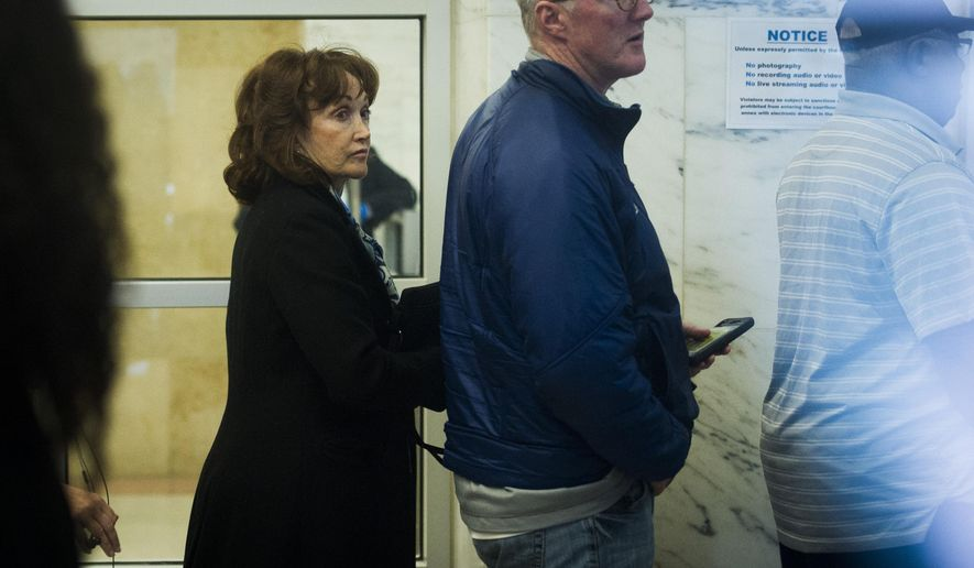 Paul Manafort's wife, Kathleen Manafort, waits to enter the U.S. District Court for Manafort's sentencing hearing in Washington, Wednesday, March 13, 2019. (AP Photo/Cliff Owen)