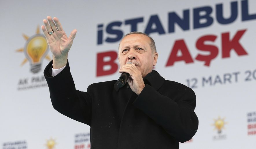 """Turkey's President Recep Tayyip Erdogan addresses the supporters of his ruling Justice and Development Party, AKP, during a rally in Istanbul, Tuesday, March 12, 2019, ahead of local elections scheduled for March 31, 2019. The banner in the background reads: """"Istanbul, a love story."""" (Presidential Press Service via AP, Pool)"""