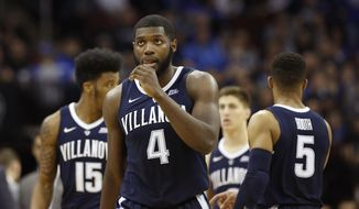 Villanova forward Eric Paschall (4) reacts as he looks at the score in the waning minutes of the second half of an NCAA college basketball game against Seton Hall, Saturday, March 9, 2019, in Newark, N.J. Seton Hall defeated Villanova 79-75. (AP Photo/Kathy Willens)