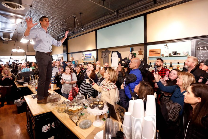 Presidential hopeful Beto O'Rourke won journalists' admiration when he leaped atop a lunch counter in Iowa on Thursday to make a point. (Associated Press)