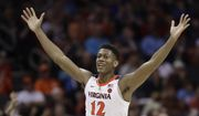 Virginia's De'Andre Hunter (12) reacts after making a basket against North Carolina State during the second half of an NCAA college basketball game in the Atlantic Coast Conference tournament in Charlotte, N.C., Thursday, March 14, 2019. (AP Photo/Chuck Burton) ** FILE **
