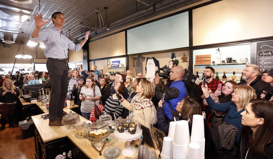 Former Texas congressman Beto O'Rourke speaks to local residents during a meet and greet at the Beancounter Coffeehouse & Drinkery, Thursday, March 14, 2019, in Burlington, Iowa. O'Rourke announced Thursday that he'll seek the 2020 Democratic presidential nomination. (AP Photo/Charlie Neibergall)