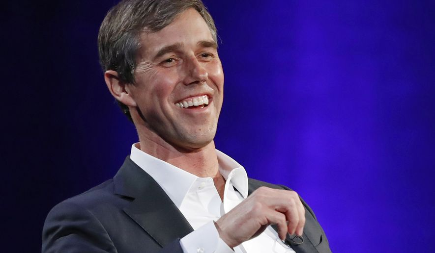 "In this Tuesday, Feb. 5, 2019 file photo, former Democratic Texas congressman Beto O'Rourke laughs during a live interview with Oprah Winfrey on a Times Square stage at ""SuperSoul Conversations,"" in New York. (AP Photo/Kathy Willens, File)"