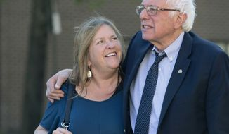 FILE - In this April 19, 2016, file photo, Democratic presidential candidate Sen. Bernie Sanders, I-Vt., and his wife Jane take a walk in State College, Pa. The Sanders Institute, a think tank founded by Democratic presidential contender Bernie Sanders wife and son, has stopped accepting donations and plans to suspend all operations by the end of May. (AP Photo/Mary Altaffer, File)