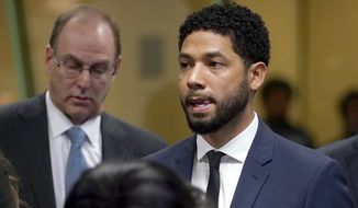 """Empire"" actor Jussie Smollet, stands before Cook County Circuit Court Judge Steven Watkins where he pled not guilty at the Leighton Criminal Court Building, Thursday, March 14, 2019 in Chicago. Smollett pleaded not guilty Thursday to charges accusing him of lying to the police about being the victim of a racist and homophobic attack in downtown Chicago a few weeks ago. (E. Jason Wambsgans/Chicago Tribune via AP, Pool)"