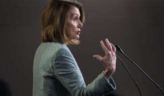 Speaker of the House Nancy Pelosi, D-Calif., meets with reporters just after the House approved a resolution calling for any final report in special counsel Robert Mueller's Russia investigation to be made public, on Capitol Hill in Washington, Thursday, March 14, 2019. (AP Photo/J. Scott Applewhite)