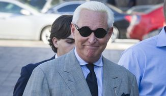 Roger Stone, an associate of President Donald Trump, arrives at the U.S. District Court, for a court status conference on his seven charges: one count of obstruction of an official proceeding, five counts of false statements, and one count of witness tampering, in Washington, Thursday, March 14, 2019. Stone has pleaded not guilty to the charges. (AP Photo/Cliff Owen)
