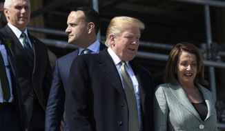 House Speaker Nancy Pelosi of Calif., right, talks with President Donald Trump, second from right, as Irish Prime Minister Leo Varadkar, second from left, and Vice President Mike Pence, left, follow as they walks down the steps of the Capitol in Washington, Thursday, March 14, 2019, following a lunch. (AP Photo/Susan Walsh)